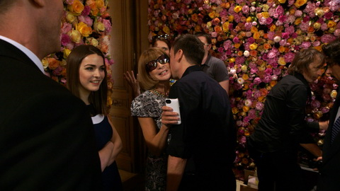 Raf Simons greets Anna Wintour in one of the flower rooms. Credit: CIM Productions