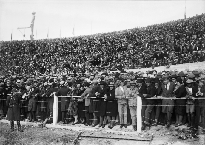 "Spectators at the slope and at the ""Ámsterdam"" stand, during a game between Uruguay and Peru the day of the opening of the Centenario Stadium."