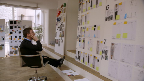Designer Raf Simons contemplates his collection boards. Credit: CIM Productions