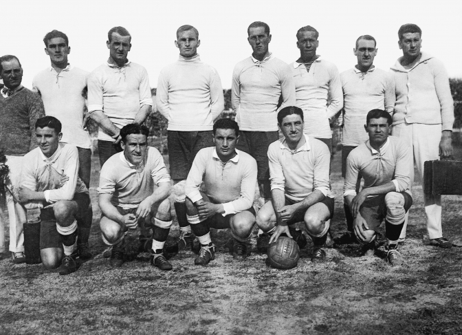 The Uruguayan team before playing the final game of the World Cup against Argentina. At the back row, E. Figoli (masseuse), A. Gestido, J. Nasazzi, E. Ballesteros, E. Mascheroni, J.L. Andrade, L. Fernandez, L. Grecco (masseuse). At the front, P. Dorado, H. Scarone, H. Castro, P. Cea, S. Uriarte. Centenario Stadium. July 30th, 1930.