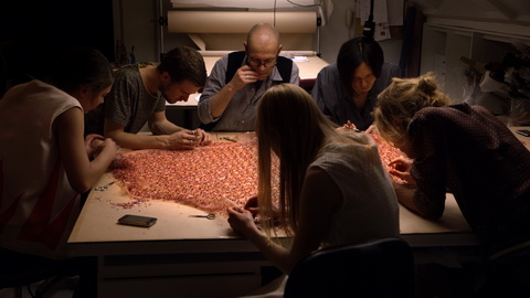 The embroidery team works late at night on the eve of the show. Credit: CIM Productions